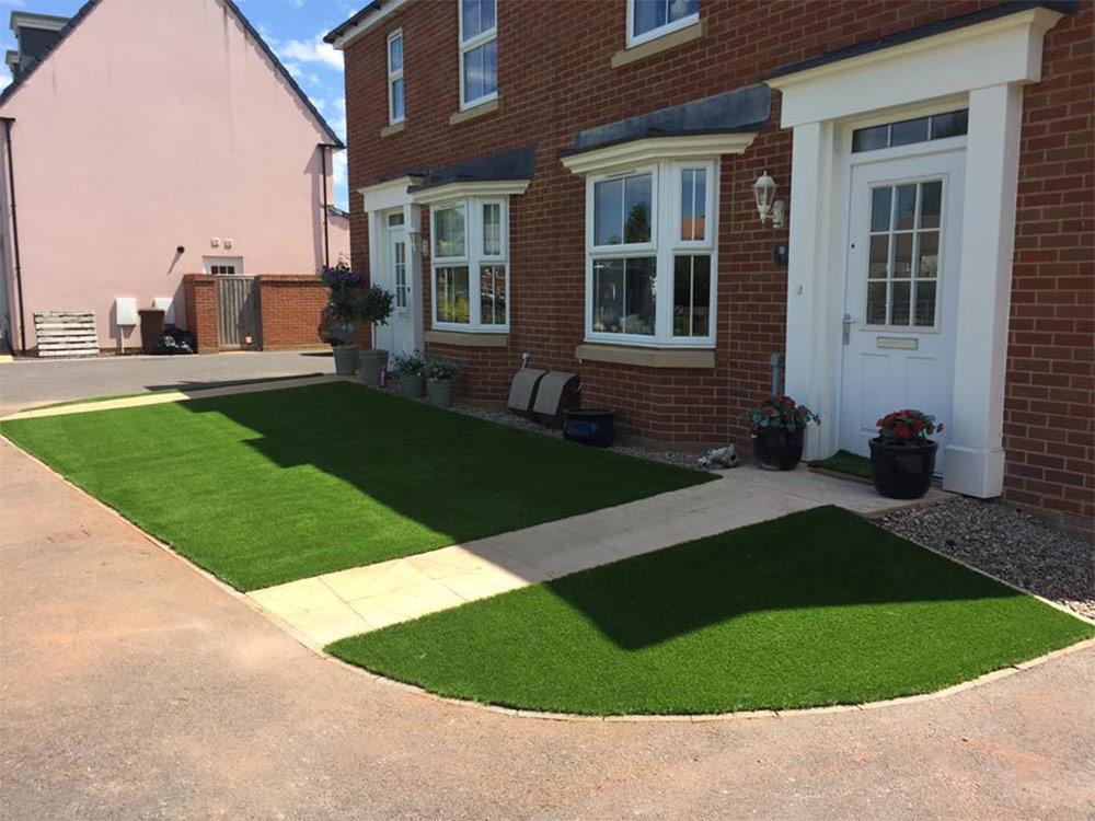 Newly fitted lawn from another angle at Cullompton properties
