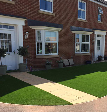 Adjoining front gardens fitted with artificial lawns