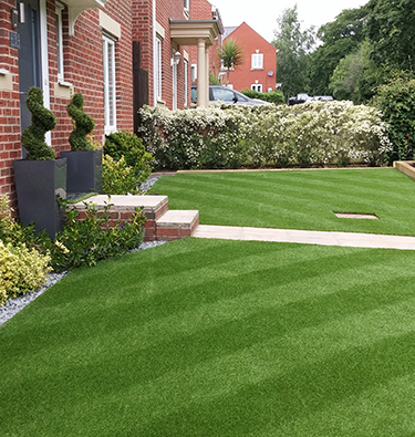 Transformed front garden with beautiful new lawn
