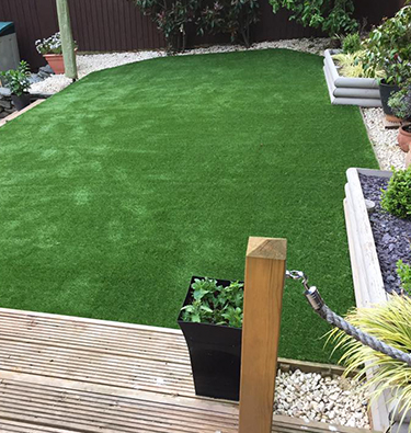 Artificially grassed area complements modern decking