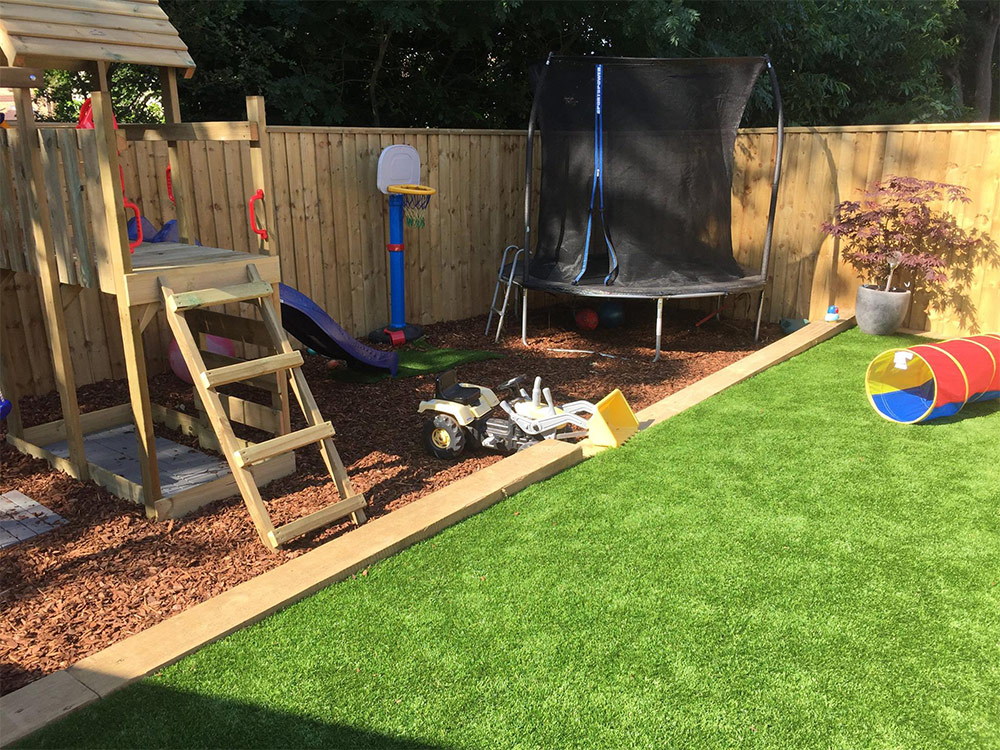 Artificially grassed and play areas in Exmouth garden