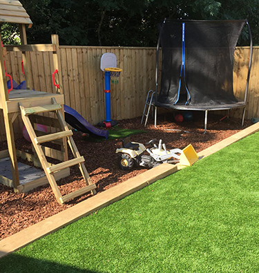 Artificially grassed family garden in Exmouth