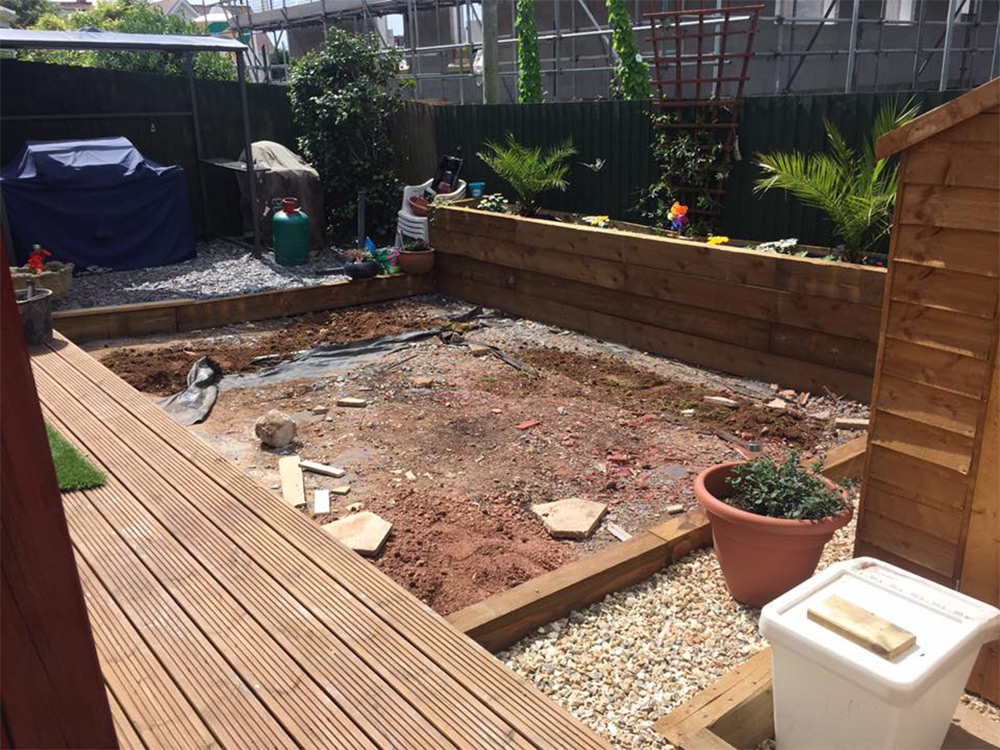 Prepping the area for our artificial grass