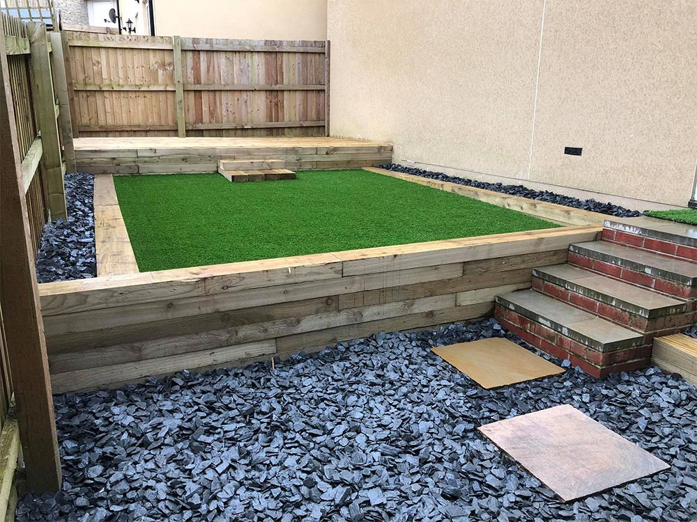 Axminster back garden after being landscaped, including a raised artificial lawn
