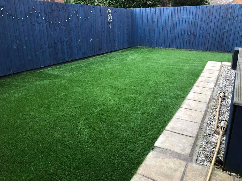 Artificial grass area in Exeter back garden by Alpyne Grass