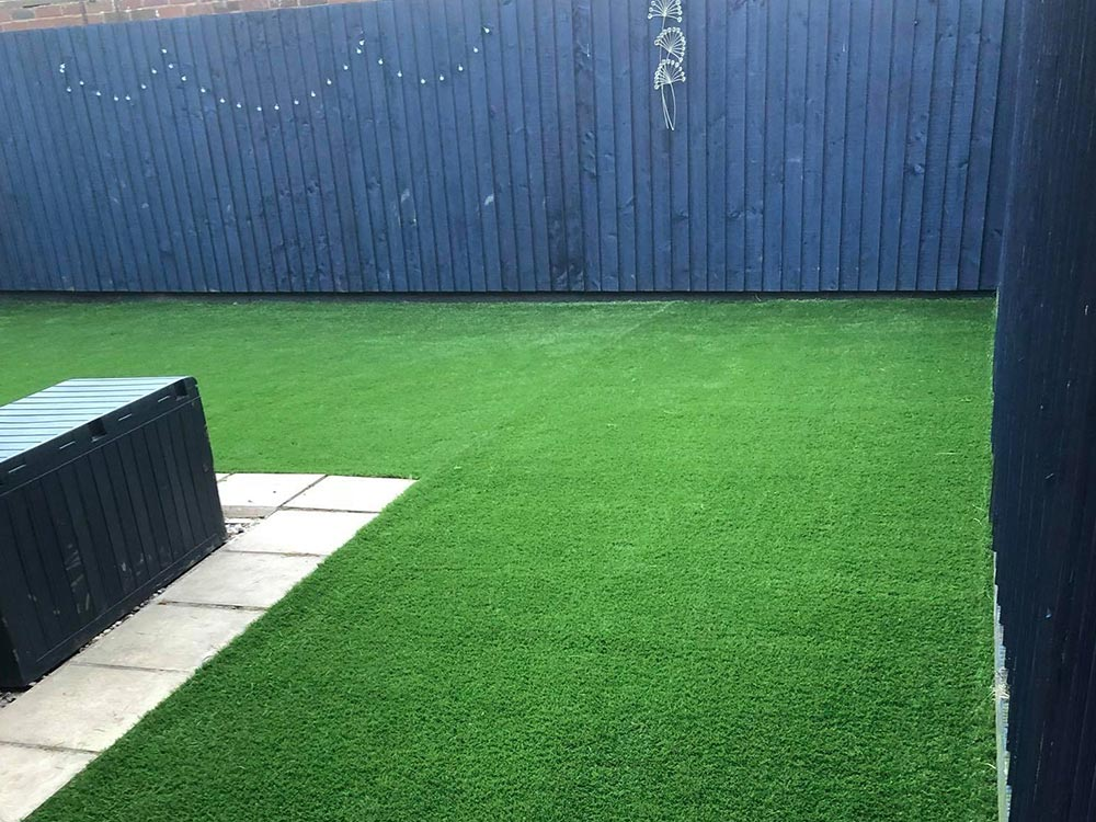 L-shape artificial lawn in Exeter back garden by Alpyne Grass