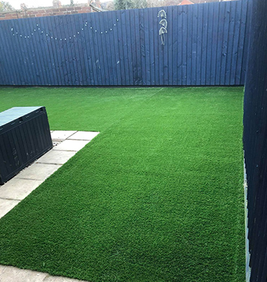 L-shaped back garden with artificial grass area