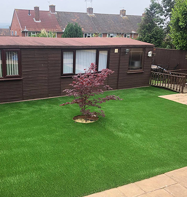 Smartening a summer house's frontage with artificial grass