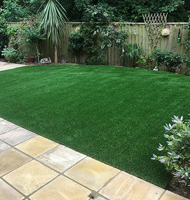 Landscaped garden with new grass and paving