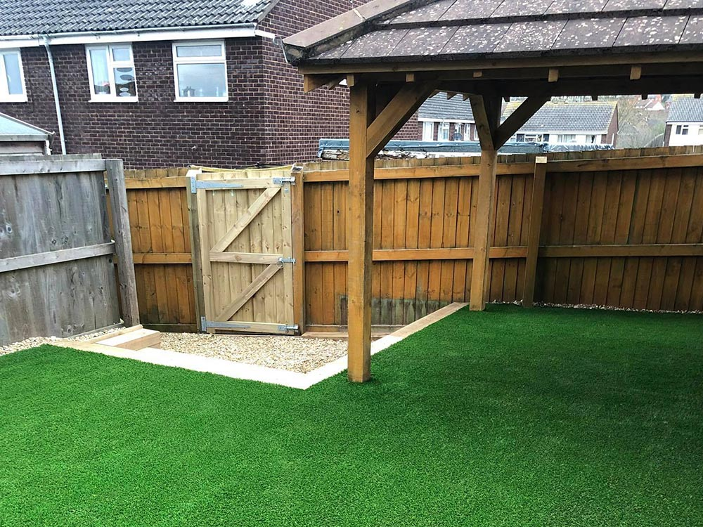 Transformed back garden space with artificial grass