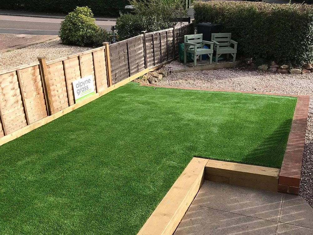 Transformed front garden shown with our artificial lawn