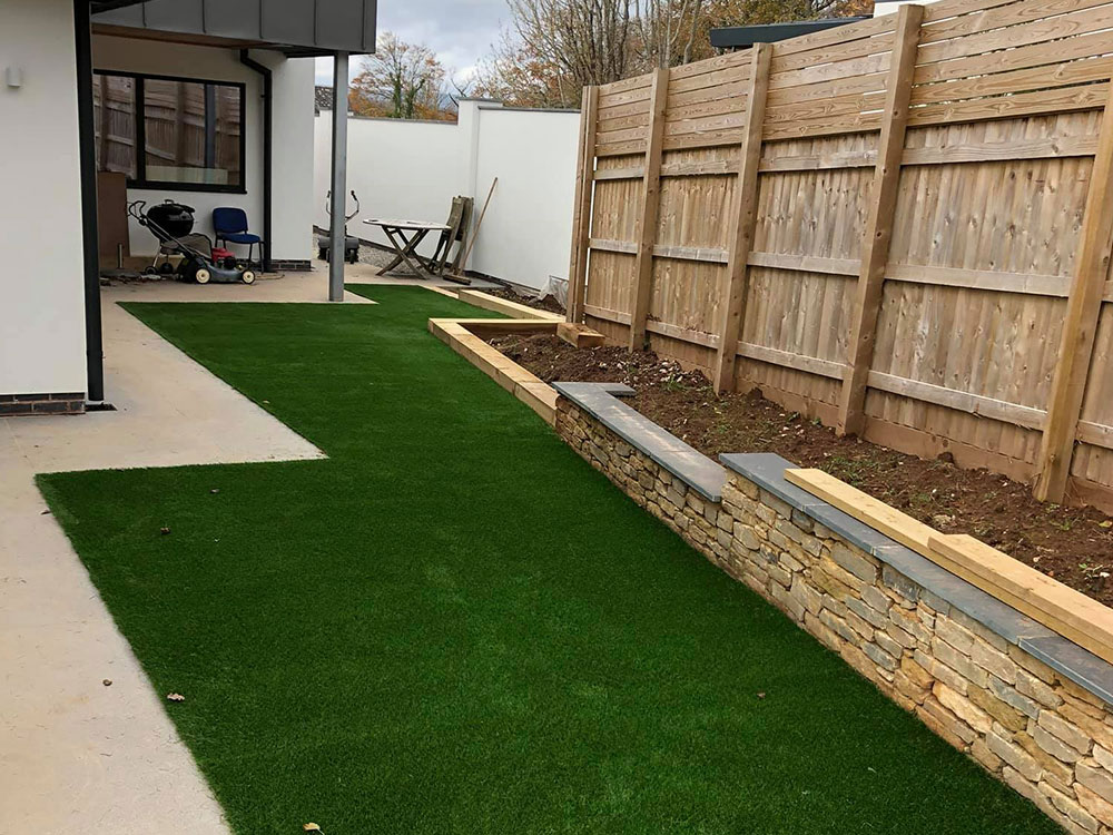 Back garden artificial lawn at new build development Exeter