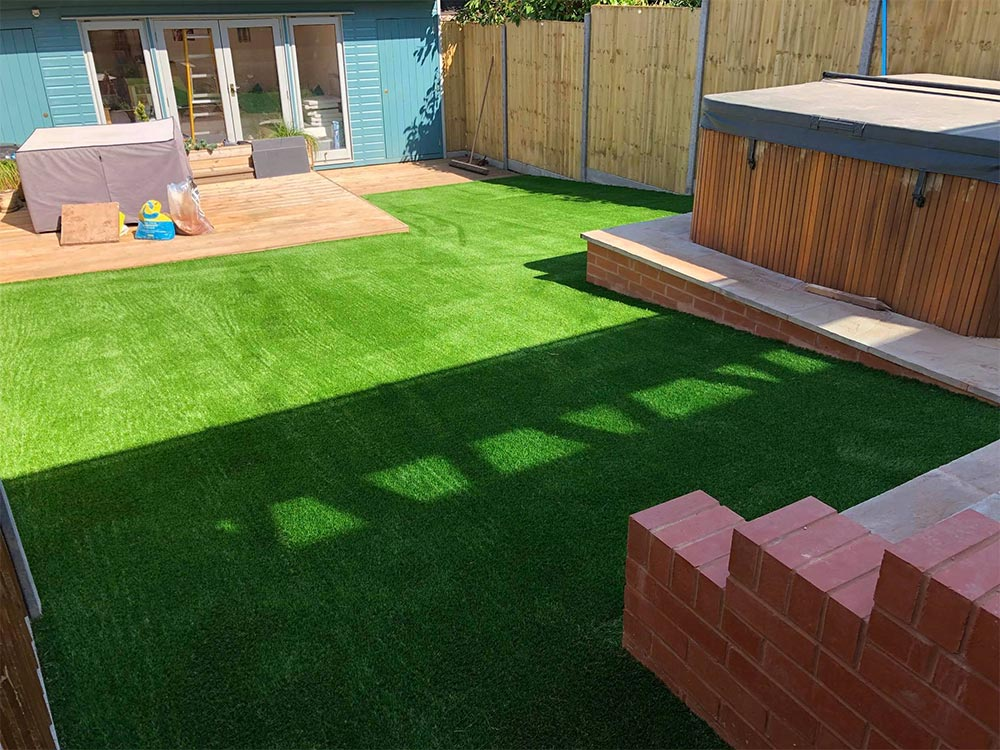 Artificial grass for a sloping garden in Exmouth