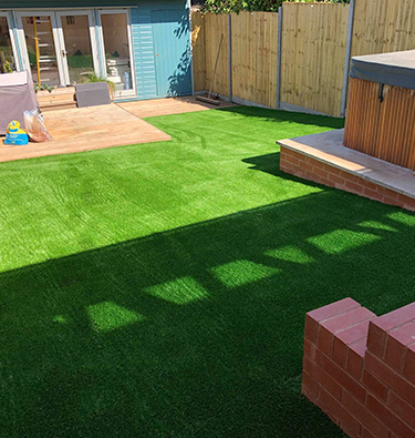 Sloping back garden lawn